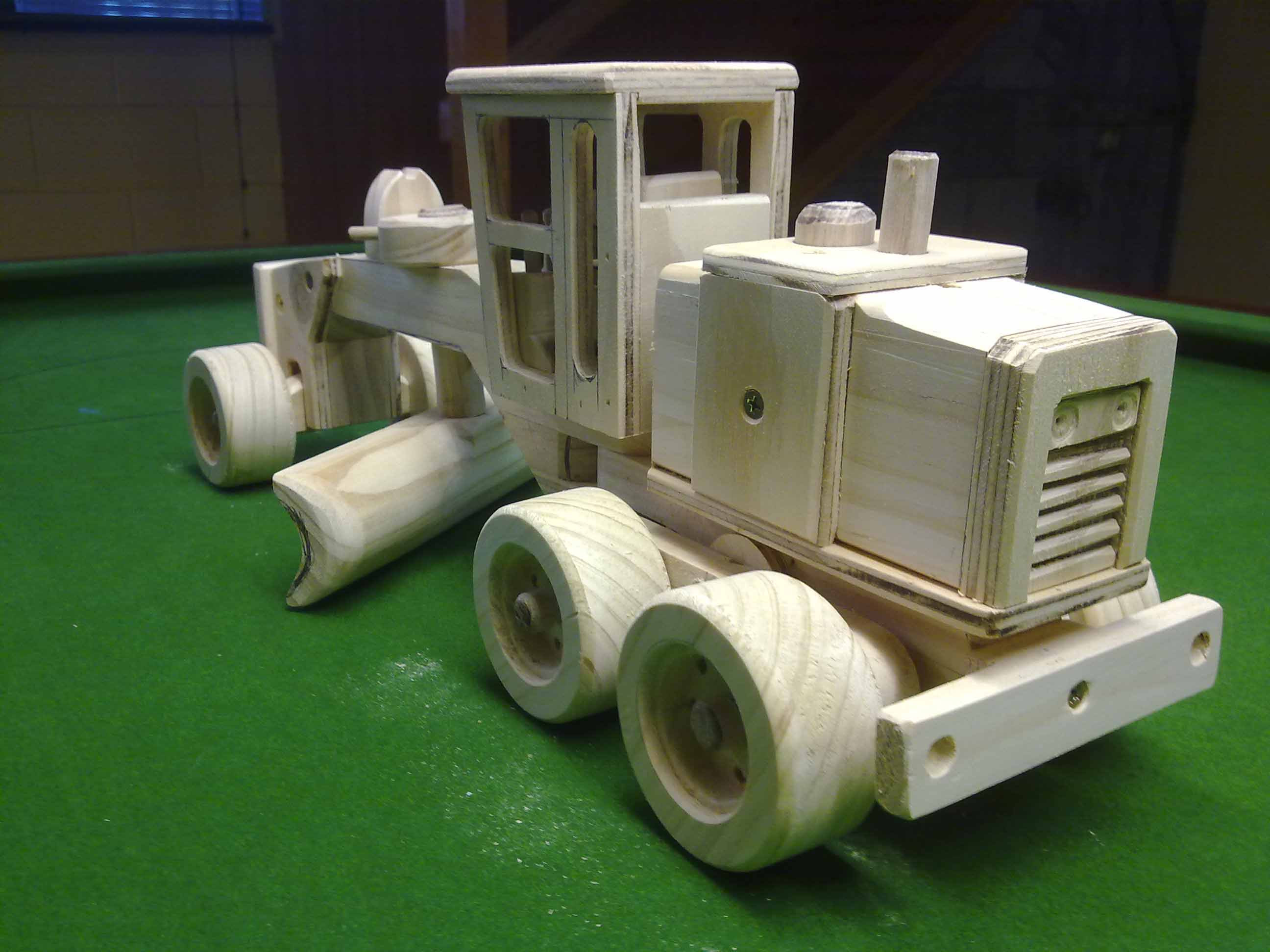 Rear view of wooden toy grader